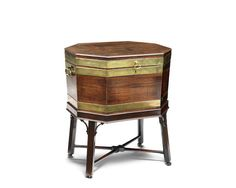 A George III mahogany and brass bound octagonal cellaret on stand