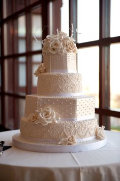 Fondant wedding cake with sugar flower details-we inspired the lace from the bride's dress