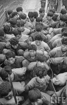 Carl Mydans—Time & Life Pictures/Getty Images Other rebels in army uniform are hauled away tightly trussed in army trucks, after their capture by loyal army forces, for trial by Korean military tribunal. Yeosu, Korean Military, Korean Peninsula, Korean People, Prisoners Of War, Asian History, Korean War, Life Pictures, Life Magazine