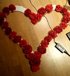 Huge heart idea made.of red ponpon.flowers made.of.red paper.napkings