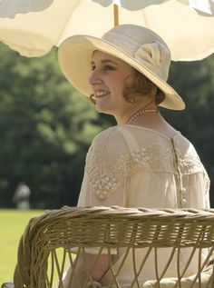 Lady Edith looking on at the cricket match.  I love the detail on her dress and the covered buttons on the back. Downton Abbey