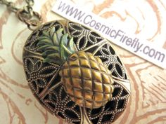 Antiqued Brass Pineapple Locket Necklace Vintage Inspired Filigree Handpainted Color Oval Locket Steampunk Necklace Tiki Locket Tiki Necklac by CosmicFirefly on Etsy https://www.etsy.com/listing/208772598/antiqued-brass-pineapple-locket-necklace
