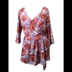 """New Eshakti Print Draped Blouse 22W New Eshakti graphic print blouse. Size 22W Measured flat: underarm to underarm:44"""" waist: 40-44"""" Length: shoulder to hem: 30"""" Eshakti size guide for bust 22: 49"""" Hidden side zipper. Faux wrap drape. Banded stitched front waist, thick elastic back waist panel. Lined in polyester moss crepe. Polyester/spandex, moss crepe, no stretch. Machine wash. Eshakti Tops Blouses"""