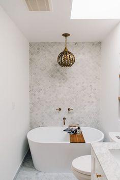 prettiest white bathroom and freestanding tub for a small bath
