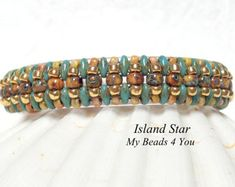 Great new design by My Beads 4 You. Made with seed beads. Great colors for all seasons. Will look great with all your outfits. measures 7 1/2 X 3/4 inches. Fits up to a 6 1/2 wrist. If you need a different size, I will be happy to make it for you. Blue Iris and a beautiful ocean mix of colors.  Great gift or better yet TREAT YOURSELF!   DIY! Start your weekend with a great beading project. https://www.etsy.com/listing/155314906/pdf-beading-tutorial-beaded-bracelet?ref=shop_home_active