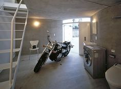 Japanese apartments with integrated motorcycle storage. Cool idea on paper - but doing laundry next to your bike seems like a bad idea to me...