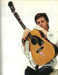 I don't know why he showed up under fleetwood mac search. i have this guitar too.  I should donate it..never use it. What is this .. .guitar night? Paul with his trusty Epiphone acoustic