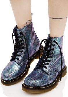 Dr. Martens Sparkle Pascal 8 Eye Boots are gunna get on tha down beat stomp, babe! Get yer legs kickin' with these totally classikk combat boots, featurin' a glam iridescent grey leather construction, thick ass treaded soles, cushioned footbed, signature yellow stitching, AirWalk pull tabs, and full length lace-ups.