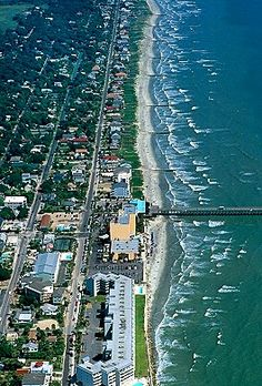 Great birds eye view of the sandy Folly Beach located just outside of Charleston, SC. Shop online to see our Beach Charms