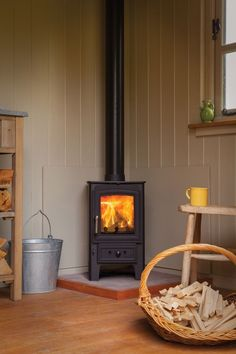 Ideas About Corner Wood Stove On Stoves Within Mesmerizing Burning Excellent Decor Kitchen Wall Ceramic Tile Design Wood, Glass Kitchen Tables, Corner Wood Stove, Kitchen Decor, Kitchen Wall Colors, Slate Kitchen, Best Kitchen Faucets, Craftsman Kitchen, Corner Stove