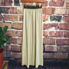 """Francessca's high-waisted Dressy high-waisted skirt from francessca's. Slightly sheer tan color, with black & gold glittery stretchy waistband. I had it hemmed a few inches & a slit sewn up. It looks gorgeous with a chiffon top tucked in. In amazing condition. I'm 5'2"""" and it reaches until the floor now. Francesca's Collections Skirts"""