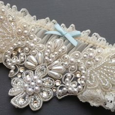Pearl and Swarovski crystal bridal garter wedding garter with blue bow for your traditional 'Something Blue'!   By Atelier Rousseau www.atelier-rousseau.com