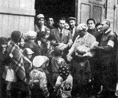 Giving bread to children, Lodz Ghetto