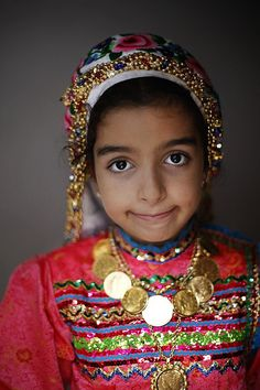 Karpathos Island (Greece).Olympus village, little girl wearing traditional Karpathian clothes. Photo by Maksid, via Flickr