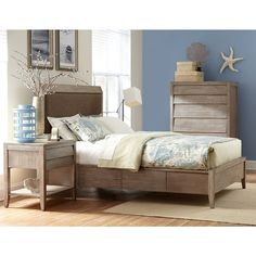 Cresent Fine Furniture's Corliss Landing Upholstered Storage Bed in Weathered Driftwood Grey by Humble Abode. Made of solid Acacia hardwood, the Corliss Landing Upholstered Bed includes nailhead trim and storage drawers.