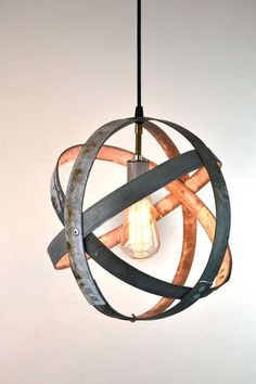 SALVAGE BY HOUZZERS Wine Country Craftsman loves to reuse Napa wine barrel rings in a unique way. One way is to turn the rings into interesting light fixtures, like this industrial pendant. Wine Barrel Furniture, Pallet Patio Furniture, Rustic Furniture, Furniture Ideas, Furniture Design, Rustic Light Fixtures, Rustic Lighting, Patio Lighting, Bedroom Lighting