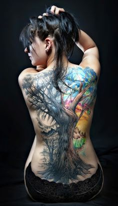 One of the best watercolor Tree tattoo design on the full back of girl looking very awesome.