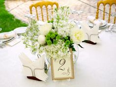 Customize your reception by using stylish table numbers as a practical addition to your table's centerpiece and decor.
