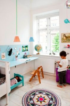 great space saving wall mounted desk for a kids room with wall display.