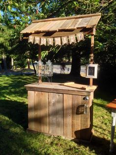 Rustic lemonade stand made from reclaimed lumber with a burlap banner.