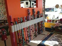 Organize photography backdrops using pvc pipe cut down and glued to plywood. Use velcro strips to secure backdrops