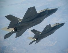 "Two F-35B test aircraft accomplish a formation test point March 17.  Lockheed Martin test pilot David ""Doc"" Nelson flew BF-2 and Royal Air Force  Squadron Leader Steve Long piloted BF-3. The F-35B and F-35C variants are  undergoing test and evaluation for delivery to the Marine Corps and Navy  respectively."
