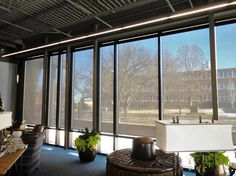 Solar shades are great for large windows in a commercial building to block UV rays and reduce energy costs by keeping it cool! #SolarShades