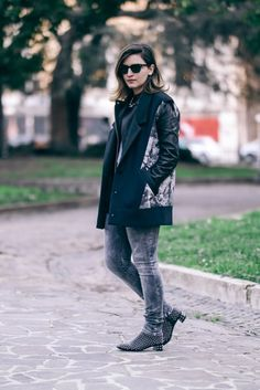 Wearing: Diesel Jeans, Leather Jacket by Gap, Sleeveless coat by Twisty Parallel Universe, Studded boots Prada, Sunglasses Rayban