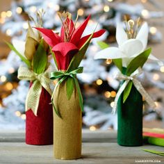 Make this simple paper amaryllis wine bottle wrap and turn a traditional host gift into something spectacular! Design and tutorial by Lia Griffith.