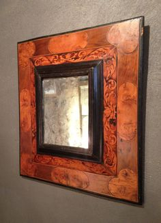 #Hugenot mirror with two frames, and reversed profiles in #native #wood #marquetry (ashwood, walnut and boxwood...). Decor of acanthus foliage and oval reserves, and hearts in the corners. These mirrors were used by Protestants to hide their Bibles on the reverse. Hearts symbolize the struggle (peak) and the union between the community (rounded inward). Vintage mercury glass. Work from the #Languedoc region, period Louis XIV around #1680. For sale on Proantic by Franck Baptiste antiquaire.