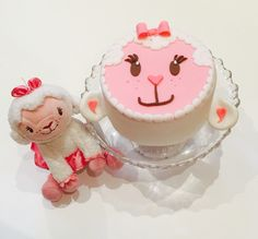 My daughters birthday cake based on Lambie from Doc Mcstuffins