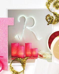 Wrap glass candleholders with punched tissue paper for a personalized party centerpiece.