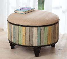 Driftwood or other salt worn boards into an ottoman. It could be built around an old tire or wheel. Also could make the top a lid for hidden storage.