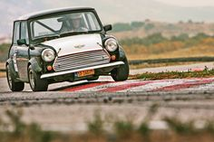 Classic Mini Cooper racing on the track