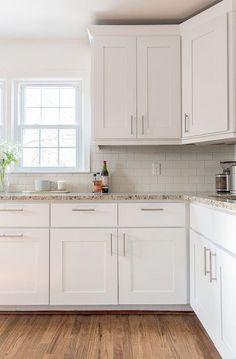 white cabinets, gold accents