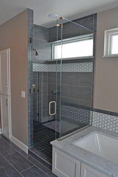 Custom heavy glass shower door and return panel.