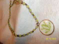 "Frog lovers  this one is for you.  18"" frog pendant with light green glass beads and silver spacers  $18.00"