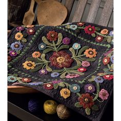 Stitch this gorgeous mini quilt by Lisa Bongean using swirling vine and flower motifs, all made with felted wool.