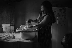 Contemporary Issues, Second Prize, Stories—<i>Victims Of The Zika Virus</i>: Adriana Cordeiro Soares, 30, bathes her son João Miguel, 3 months old, who was born with microcephaly caused by the Zika virus, in her house in the rural area of São Vicente do Seridó. In September of 2015, babies in Brazil began to be born with microcephaly and other malformations, and in April of 2016 the link between the Zika virus and these malformations was confirmed. Northeastern Brazil, where most of the…