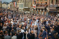 Dutch civilians dancing in the streets after the liberation of Eindhoven by Allied forces, September 1944 (Imperial War Museum ) Eindhoven, Bernard Montgomery, Crusader Tank, Operation Market Garden, Photo Record, Film Images, Colour Images, Field Marshal, Boot Camp