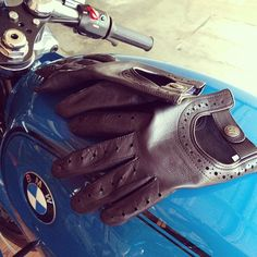 Gentleman's spring/summer accessories: leather driving gloves & classic BMW motorcycle