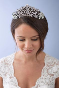 Antique Wedding Crown is a stunning vintage-inspired headpiece that will make heads turn on your wedding day. Set in silver this crown boasts ornate scrolling patterns embellished with sparkling round and pear-shaped rhinestones. The headpiece measures approximately 2  inches at its widest point. Pin loops are located on both ends and can be easily fastened in your hair with bobby pins.  Antique Bridal Crown by Dareth Colburn Collection. Accessories - Hair Accessories Accessories - Bridal…