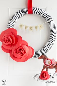 Make this cute DIY Paper Flower Wreath, a decorating idea for the Kentucky Derby. Tutorial for a cute Derby Party Decoration; a Derby Wreath Paper Flower Wreaths, Paper Flowers, Floral Wreaths, Run For The Roses, Polka Dot Chair, Derby Party, Race Party, Wreath Tutorial, Roller Derby