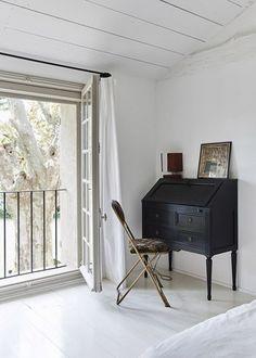 vintage black desk with vintage chair in white bedroom. / sfgirlbybay