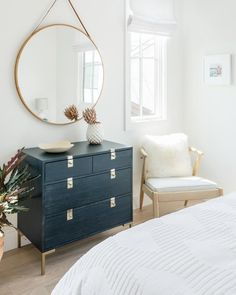 =Bright, natural light makes any room feel a little more luxe. Get the look at theshadestore.com // Designed by Salthouse Collective // Photo by Charlotte Lea Photography // Material by Sunbrella Nautical Looks, Bedroom Windows, Wooden Pegs, Dresser As Nightstand, Beautiful Bedrooms, Master Bedroom, Mirror, Storage, Wall