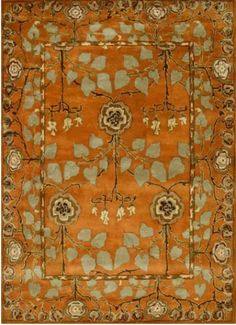 This Tufted Pumpkin Rug made of wool and silk adds a splash of colour to the otherwise neutral dining room. The pattern is reminiscent of the French Country style of decor.  Please visit our blog to know more!