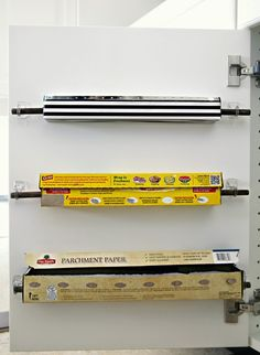 organize kitchen wraps on inside of cupboard door