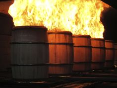 Oak Barrels being charred before use.  It's what gives bourbon it's flavor and unique color.