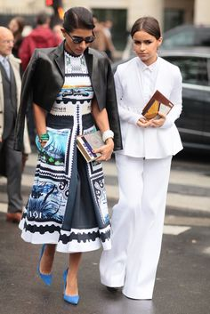 Miroslava Duma's all-white suiting made for quite a contrast alongside her print-clad companion.