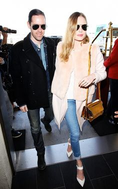 Kate Bosworth wearing a long coat with fur collar, white top, skinny cuffed jeans, and white pointed-toe heels with strap